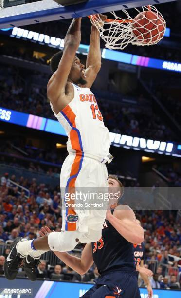Florida's Kevarrius Hayes dunks over Virginia's Jack Salt during the second round of the NCAA Tournament at the Amway Center in Orlando Fla on...