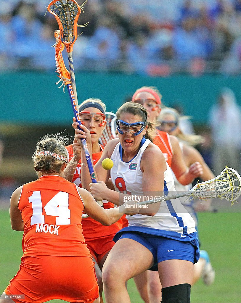 Florida's Shannon Gilroy (8) chases the ball as Syracuse's Kasey Mock (14) defends during the Orange Bowl Lacrosse Classic against Syracuse at Sun Life Stadium in Miami Gardens, Florida, on Saturday, March 2, 2013.