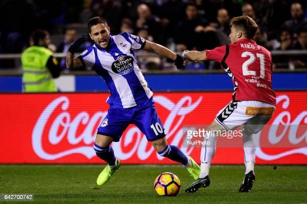 Florin Andone forward of Deportivo de La Coruña battles for the ball with Kiko Femenia defender of Deportivo Alaves during the La Liga Santander...