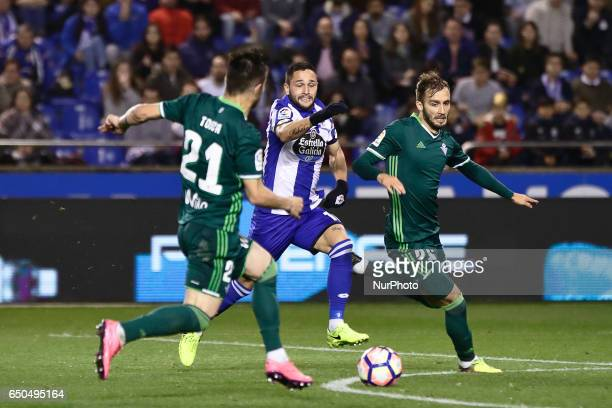 Florin Andone forward of Deportivo de La Coruña compete for the ball against Alin Tosca defender of Real Betis Balompie and German Pezzella defender...