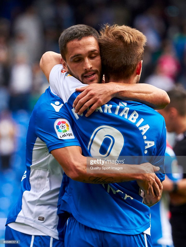 Florin Andone of Deportivo de La Coruna celebrate the victory with Fede Cartabria of Deportivo de La Coruna during the La Liga match between Deportivo La Coruna and Getafe at Abanca Riazor Stadium on September 30, 2017 in La Coruna, Spain.