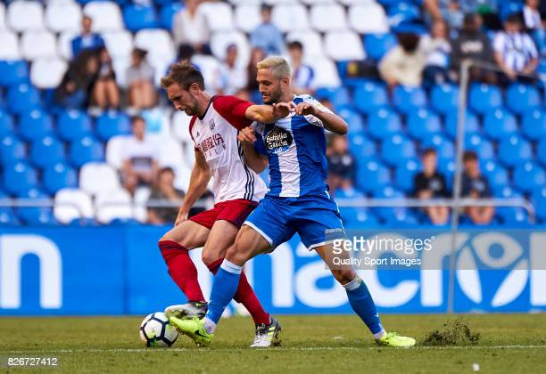 Florin Andone of Deportivo de La Coruna competes for the ball with Craig Dawson of West Bromwich Albion during the Pre Season Friendly match between...