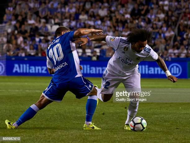 Florin Andone of Deportivo de La Coruna competes for the ball with Marcelo Vieira of Real Madrid during the La Liga match between Deportivo La Coruna...