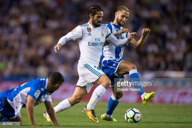 Florin Andone of RC Deportivo La Coruna competes for the ball with Isco of Real Madrid during the La Liga match between Deportivo La Coruna and Real...