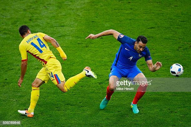 Florin Andone of Romania and Adil Rami of France compete for the ball during the UEFA Euro 2016 Group A match between France and Romania at Stade de...