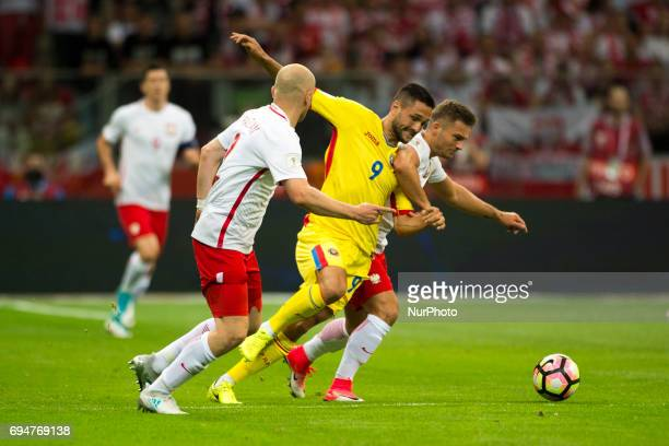 Florin Andone of Romania fights for the ball with Karo Linetty of Poland during the FIFA World Cup 2018 Qualifying Group E match between Poland and...