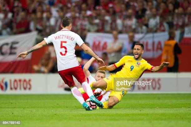 Florin Andone of Romania tackled by Krzysztof Maczynski and Jakub Blaszczykowski of Poland during the FIFA World Cup 2018 Qualifying Group E match...