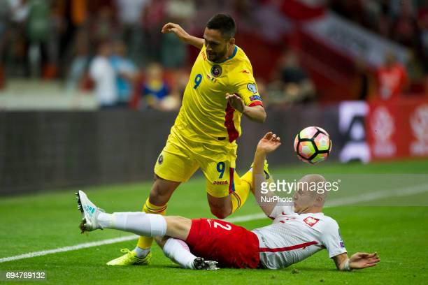Florin Andone of Romania tackled by Michal Pazdan of Poland during the FIFA World Cup 2018 Qualifying Group E match between Poland and Romania at PGE...