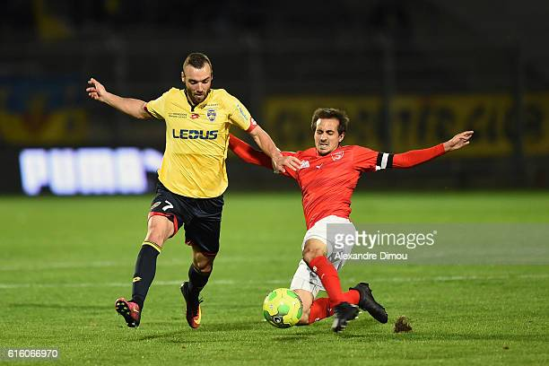 Florin Berenguer of Sochaux and Fethi Harek of Nimes during the Ligue 2 match between Nimes Olympique and Sochaux on October 21 2016 in Nimes France
