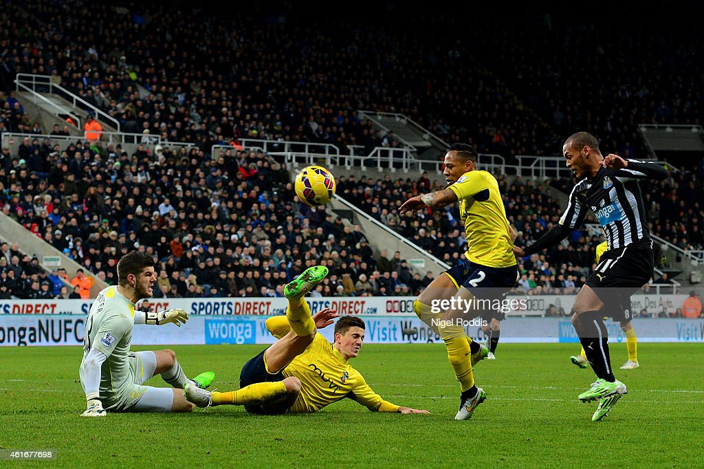 Florin Gardos of Southampton slides in to clear the ball ahead of <a gi-track='captionPersonalityLinkClicked' href=/galleries/search?phrase=Fraser+Forster&family=editorial&specificpeople=4185429 ng-click='$event.stopPropagation()'>Fraser Forster</a> before it rebounds off <a gi-track='captionPersonalityLinkClicked' href=/galleries/search?phrase=Yoan+Gouffran&family=editorial&specificpeople=534470 ng-click='$event.stopPropagation()'>Yoan Gouffran</a> of Newcastle United to score his team's first goal during the Barclays Premier League match between Newcastle United and Southampton at St James' Park on January 17, 2015 in Newcastle upon Tyne, England.