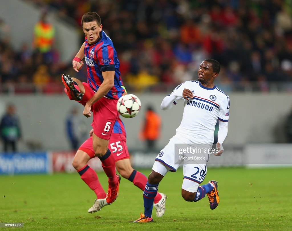 Florin Gardos (L) of Steaua Bucuresti clears from <a gi-track='captionPersonalityLinkClicked' href=/galleries/search?phrase=Samuel+Eto%27o&family=editorial&specificpeople=210530 ng-click='$event.stopPropagation()'>Samuel Eto'o</a> (R) of Chelsea during the UEFA Champions League Group E Match between FC Steaua Bucuresti and Chelsea at the National Arena Stadium on October 1, 2013 in Bucharest, Romania.