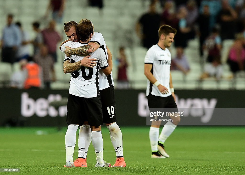 Florin Lovin and Denis Alibec of FC Astra Giurgiu celebrate following the UEFA Europa League match between West Ham United and FC Astra Giurgiu at the Olympic Stadium on August 27, 2016 in London, England.