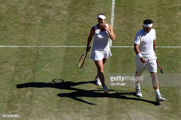 Florin Mergea of Romania and Elina Svitolina of Ukraine play in a Mixed Doubles third round match against Neal Skupski and Naomi Broady of Great...