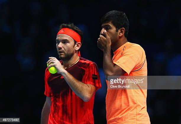 Florin Mergea of Romania and Rohan Bopanna of India talk in their men's doubles match against Bob Bryan and Mike Bryan of the United States during...
