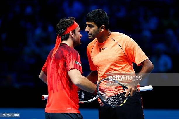 Florin Mergea of Romania celebrates victory with Rohan Bopanna of India in their men's doubles match against John Peers of Australia and Jamie Murray...