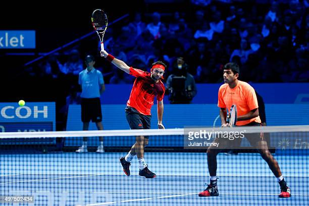 Florin Mergea of Romania plays a backhand partnering Rohan Bopanna of India in their men's doubles match against John Peers of Australia and Jamie...