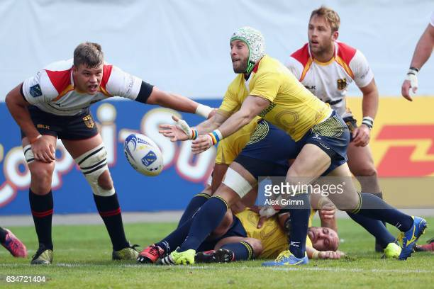 Florin Surugiu of Romania is challenged by Sebastian Ferreira and Jacobus Otto of Germany during the European Shield Rugby match between Germany and...