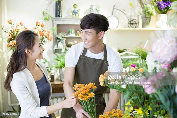 Florist and customer in flower shop