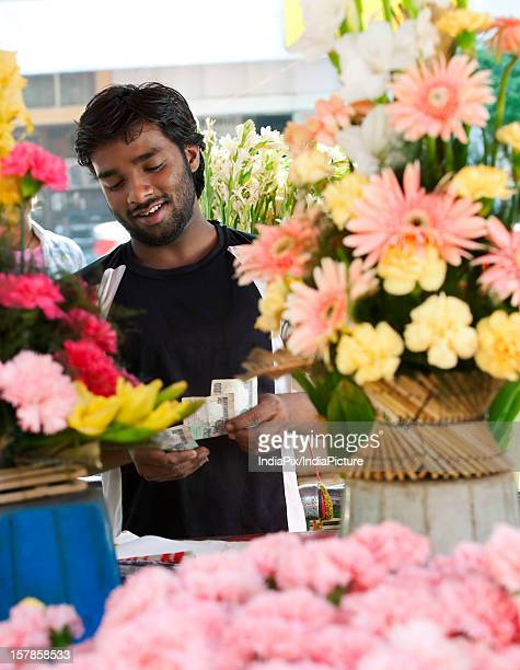 Florist counting his money
