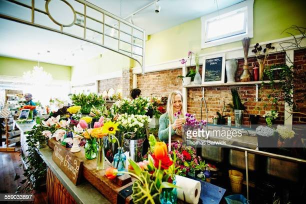 Florist creating arrangement in flower shop