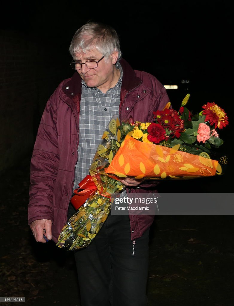 A florist delivers flower to a house belonging to broadcaster Dave Lee Travis on November 15, 2012 near Leighton Buzzard, England. Police say that they have arrested a man in his 60s as part of an investigation into allegations of sexual abuse by broadcaster Jimmy Savile.