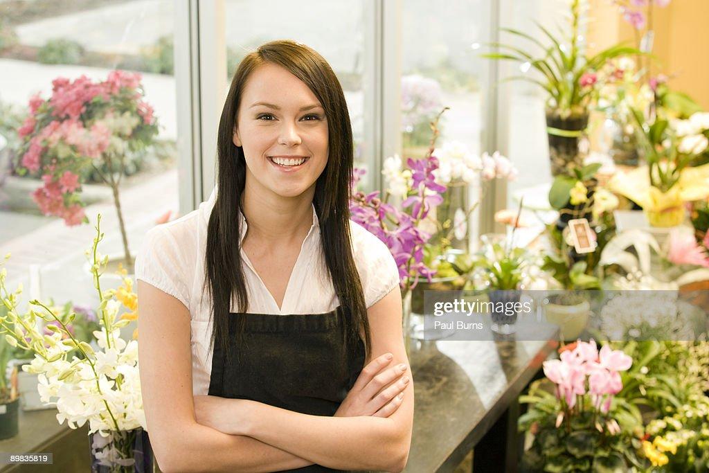 Florist Employee Standing With Flower Arrangements : Stock Photo
