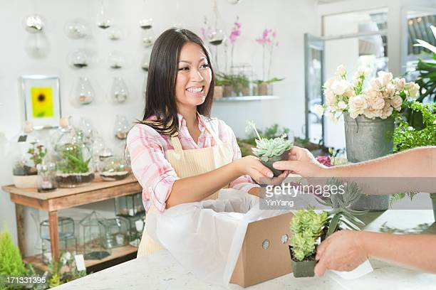 Florist Flower Shop Owner Serving Customer in Retail Store Hz