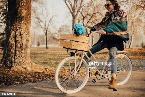 Florist girl riding a bicycle trough the park