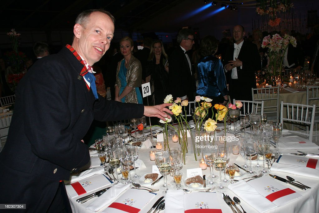 Florist Gunnar Kaj points at the floral arrangements on a table at the opening gala of Nordic Cool 2013 festival at the Kennedy Center in Washington, D.C., U.S., on Tuesday, Feb. 19, 2013. The Nordic Cool festival, which runs through March 17, celebrates the cultures of Denmark, Finland, Sweden, Norway and Iceland through live performances, films, panels, along with art, fashion and design exhibitions at the Kennedy Center. Photographer: Stephanie Green/Bloomberg via Getty Images
