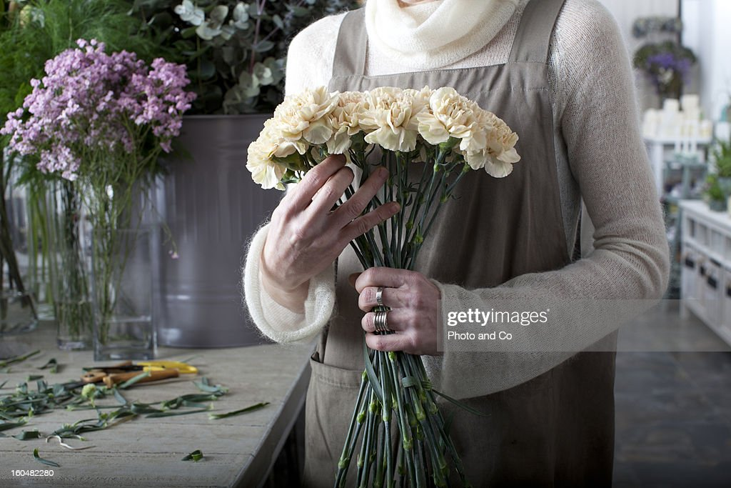 florist making a bouquet of flowers : Stock Photo