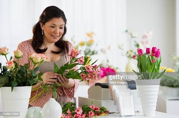 Florist making a floral arrangement