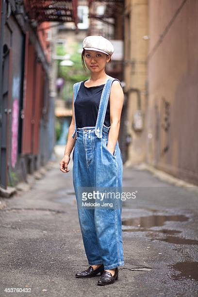 Florist Miki Onuma wears her her boyfriend's denim overalls and hat and Stuart Weitzman shoes in July 2012 on the Lower East Side in New York City
