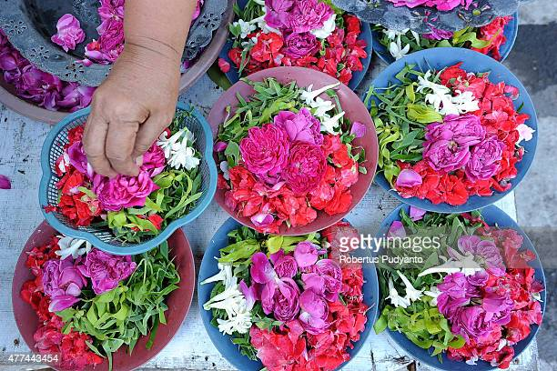 A florist prepares floral offerings for visitors making pilgrimages to the graves of family members as Indonesian Muslims begin fasting for Ramadan...