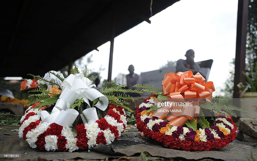 A florist sells flowers outside Nairobi's mortuary on September 25, 2013 as Kenyan troops and rescue workers scoured the wreckage of a Nairobi shopping mall for bodies and booby-trapped explosives after a four-day siege by Islamist gunmen left 67 dead and dozens more missing.