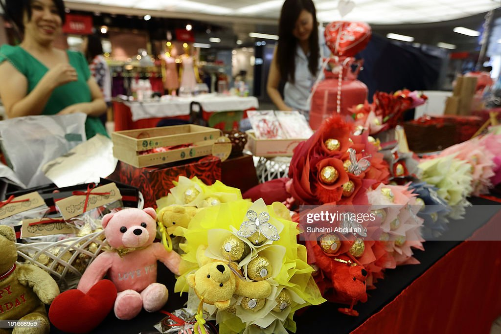 A florist sells Valentine's day gift items at Raffles Place on February 14, 2013 in Singapore. Valentine's Day is a time to celebrate love, romance and friendship and is celebrated worldwide annually in different ways on February 14.