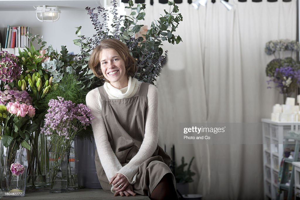 florist smiling in flower shop : Stock Photo