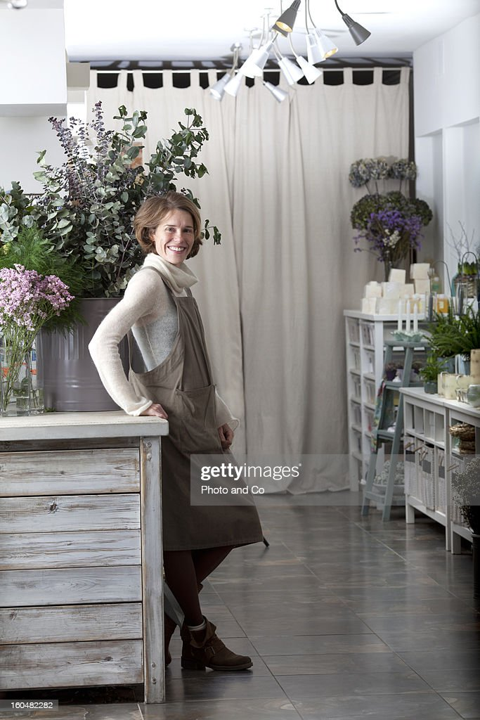 florist smiling in flower shop