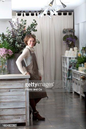 florist smiling in flower shop