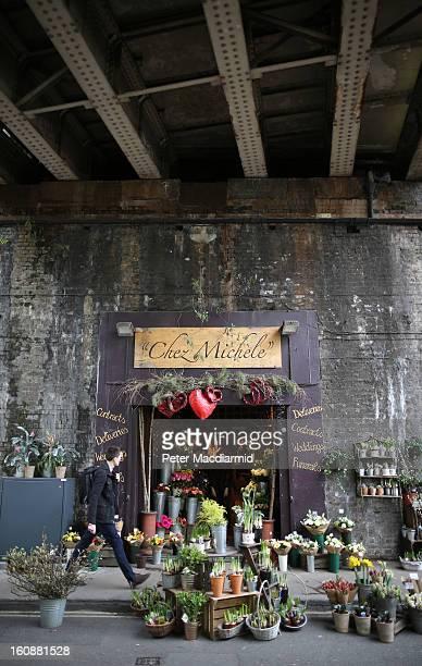 A florist's shop spills out onto the street under a railway bridge at Borough Market on February 7 2013 in London England Borough Market London's...