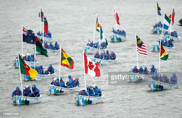 A flotilla of FiftyFive Trinity 500's crewed by sea cadets from across Britain carring the 54 Commonwealth flags travel down the River Thames during...