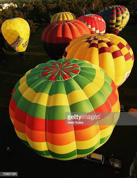 A flotilla of hot air balloons are seen as they prepare to take to the air as part of the Sky Orchestra hot air balloon and musical flotilla...