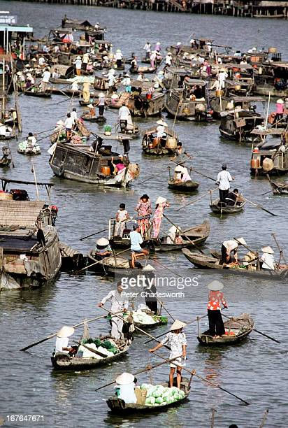 A flotilla of small row boats form a floating market on a river near Can Toa on the Mekong Delta