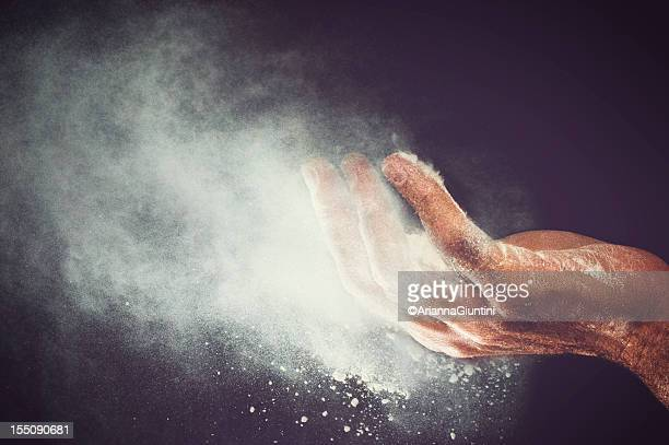 flour blew from the hand