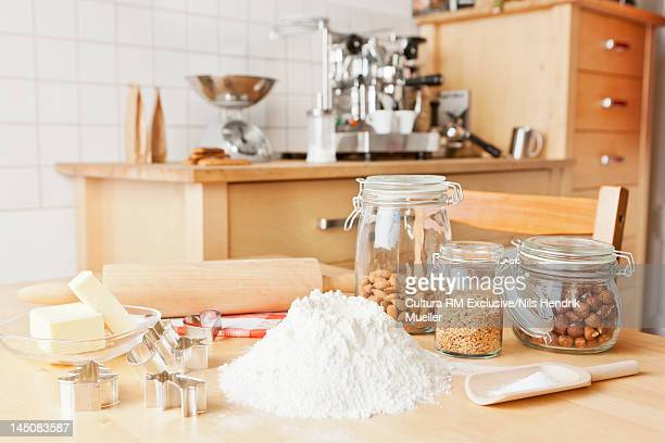 Flour, nuts, butter and cooking utensils