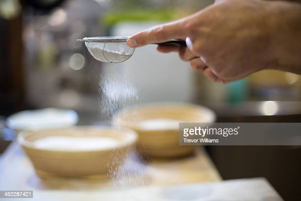 flour passing through a sieve