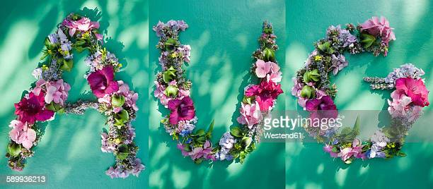 Flower arrangement building first three letters of august