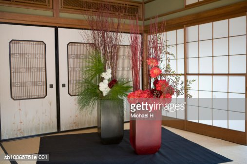 Japanese House Inside flower arrangement inside traditional japanese house stock photo