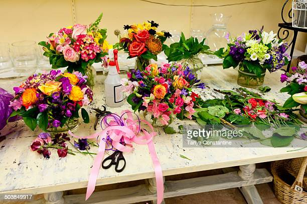 Flower arrangements on work table in florist
