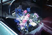 Flower bouquet on a seat of car, high angle view, differential focus