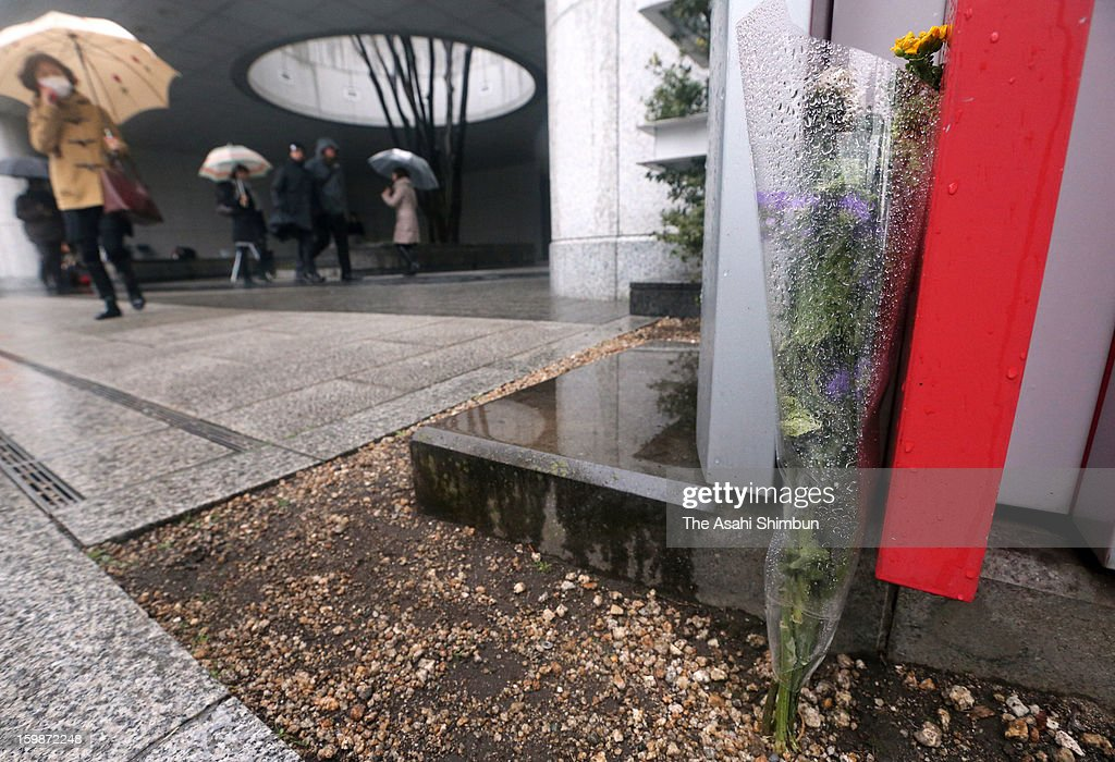 A flower bunch is offered at Japanese plant constructor JGC Co headquarters on January 22, 2013 in Yokohama, Kanagawa, Japan. Japanese government officials, president and staffs of Japanese plant constructor JGC Co, who are in In Anemas confirmed seven Japanese nationals were killed in the Algerian hostage crisis.